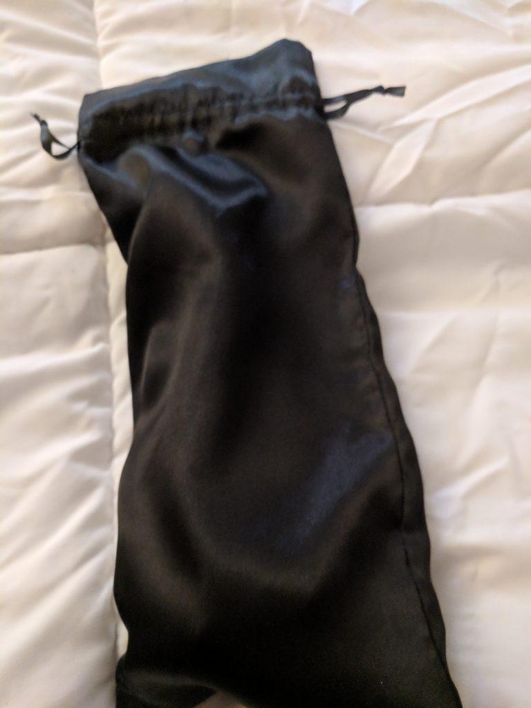 Black bag with mystery dildo inside