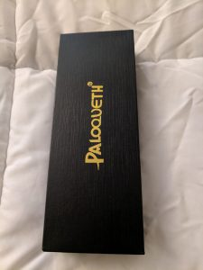 Paloqueth black box with gold lettering